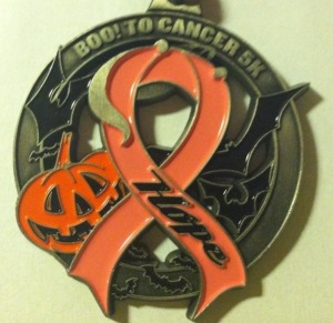 The Boo to Cancer 5K medal