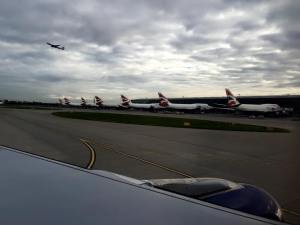 747-400s at Heathrow with 777 taking off in the background.