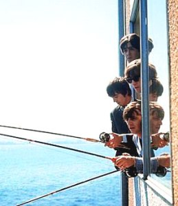 The Beatles fishing from their room at The Edgewater